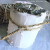 White Pillar candle with sage on top